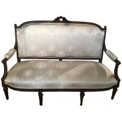 Louis XVI Style Settee, 19th Century Walnut with New Upholstery