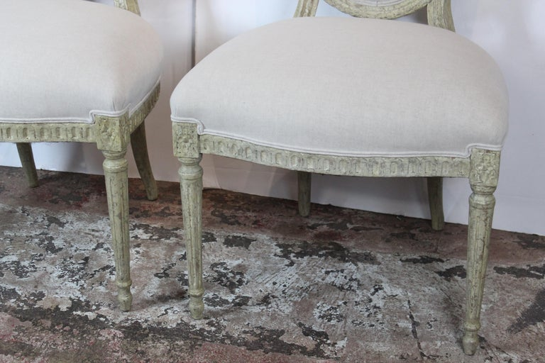 Louis XVI style side chairs. Upholstered in linen.