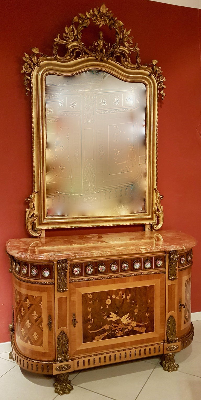 Reproduction of the original sideboard made in 1788 by Guillaume Beneman, originally located in the chamber of Louis XVI at the castle of Campiegne. The sideboard was built in the 1940s and is composed of 3 doors including 2 curves and 1 straight,