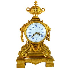 Louis XVI Style Urn and Lions Head Clock
