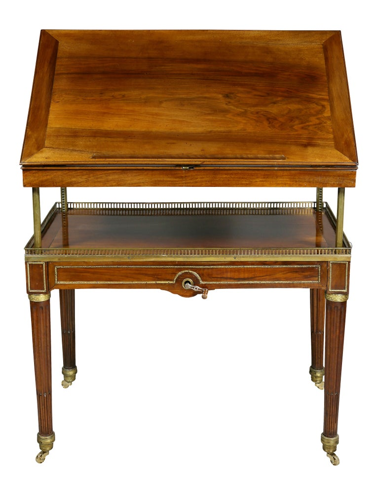 A fine and unusual piece with gilt bronze mounts, when in table position rectangular with a ratcheted adjustable slant lid , a winding key raised and lowers the reading, working section, brass bars are set inside legs and raise and lower within it.