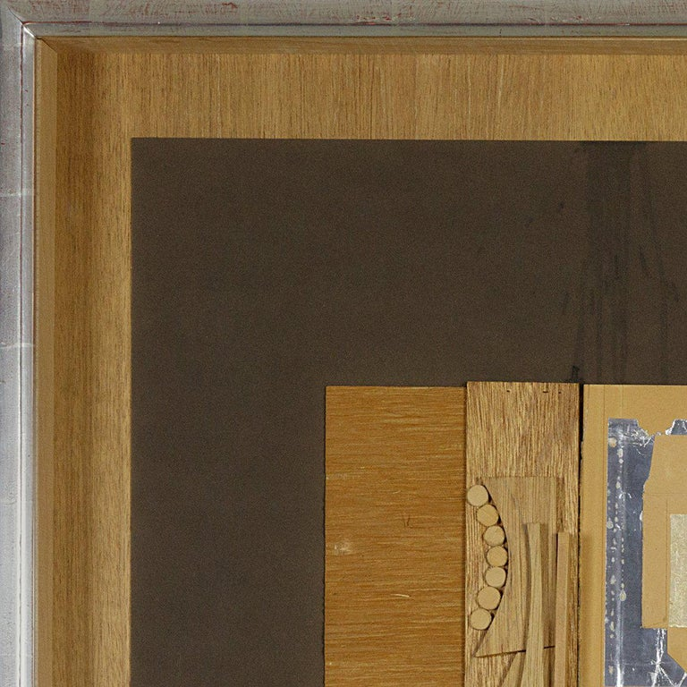 An abstract wood and paper collage executed in earth brown tones by Louise Nevelson. Signed lower right,