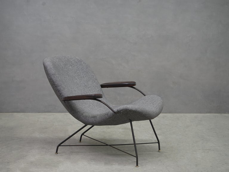 Designed by Carlo Hauner and Martin Eisler, modern Brazilian armchair, iron, brass, rosewood and grey linen, Brazil, circa 1950s. 