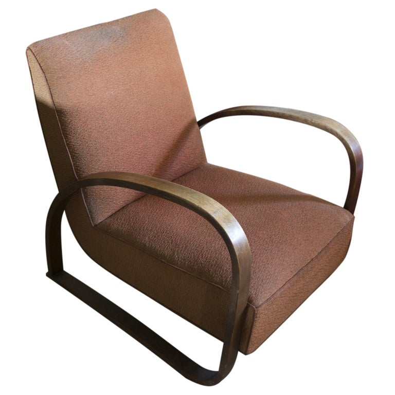 Art Deco ebonized bentwood armchair No. H-70 designed by Jindrich Halabala in the 1930s. it features an original upholstery. The wooden structure is in good original condition.