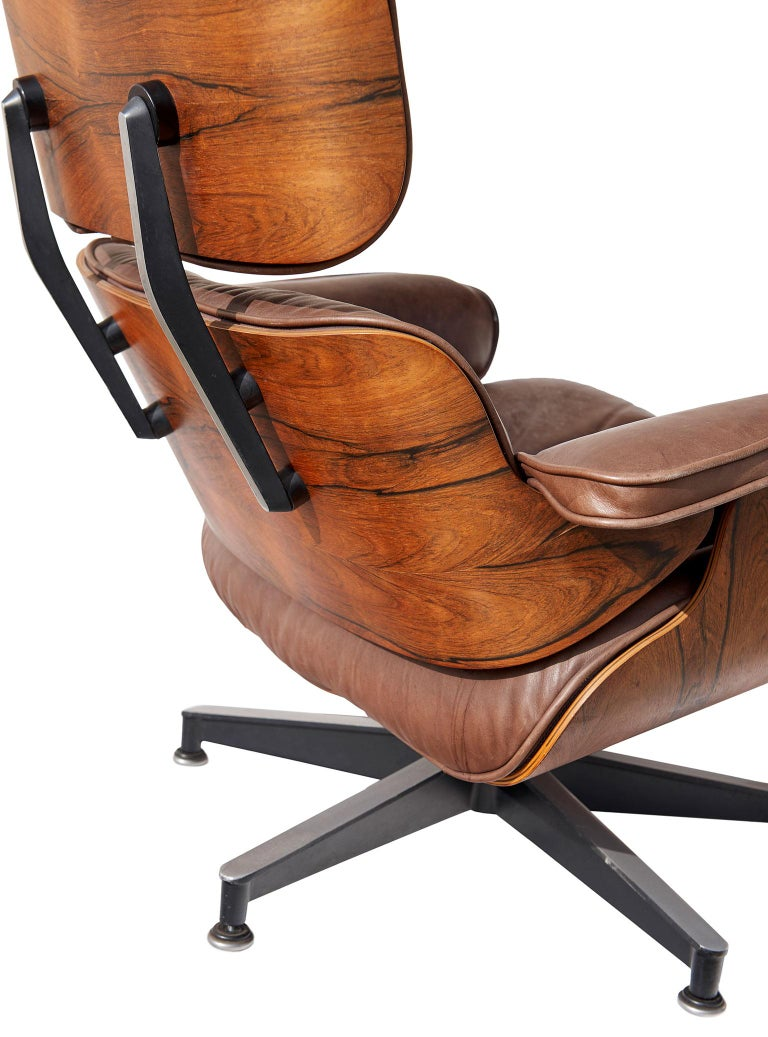 Veneer Lounge Chair and Ottoman by Charles and Ray Eames For Sale