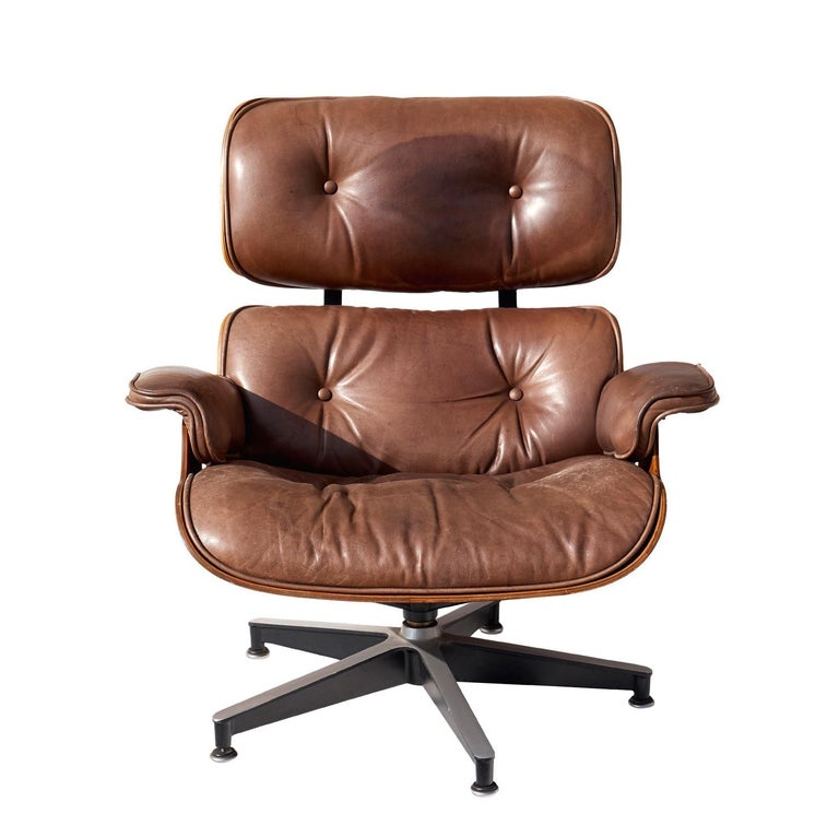 Rosewood Lounge Chair and Ottoman by Charles and Ray Eames For Sale