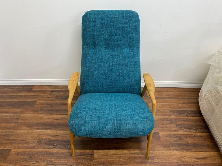 Lounge chair with ottoman by Alf Svensson for DUX of Sweden, circa 1950s. Newly upholstered in a new tweed fabric. The chair features a high back and Dual angle adjustment setting. Solid sculptural birch frame with brass accents. The birch frames