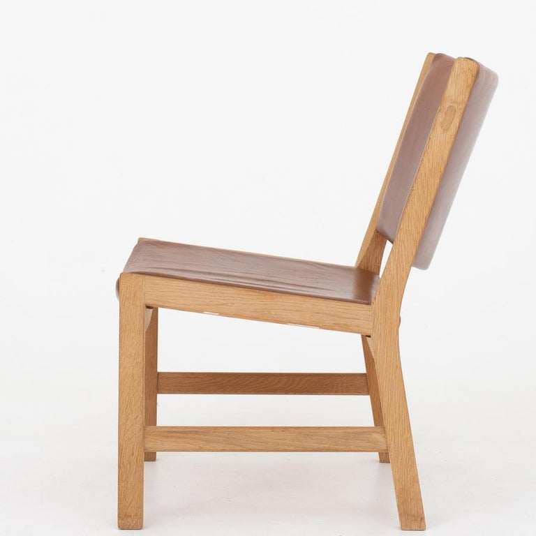 AP 54 - rare lounge chair in oak with brown leather. Maker AP Stolen.
