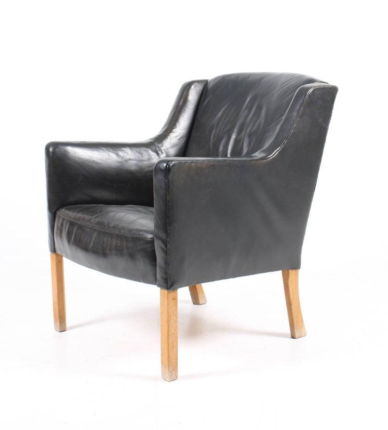 Scandinavian Modern Lounge Chair by Ole Wanscher For Sale