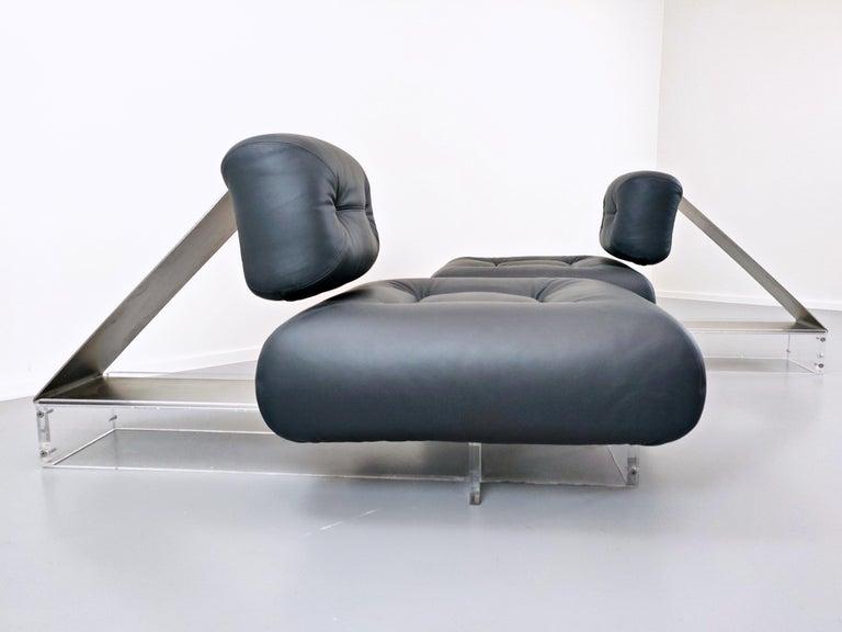 Lounge chair by Oscar Niemeyer in plexiglass, steel and black leather.