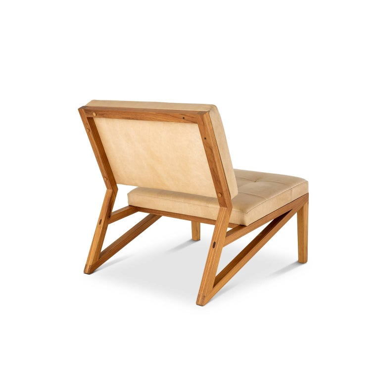 The lounge chair Cim is made in Brazilian solid wood freijó with traditional handcraft joint techniques. The seat is in plywood, straps, foam and leather. Finishing in Italian acrylic matte varnish that shows the beauty of wood.