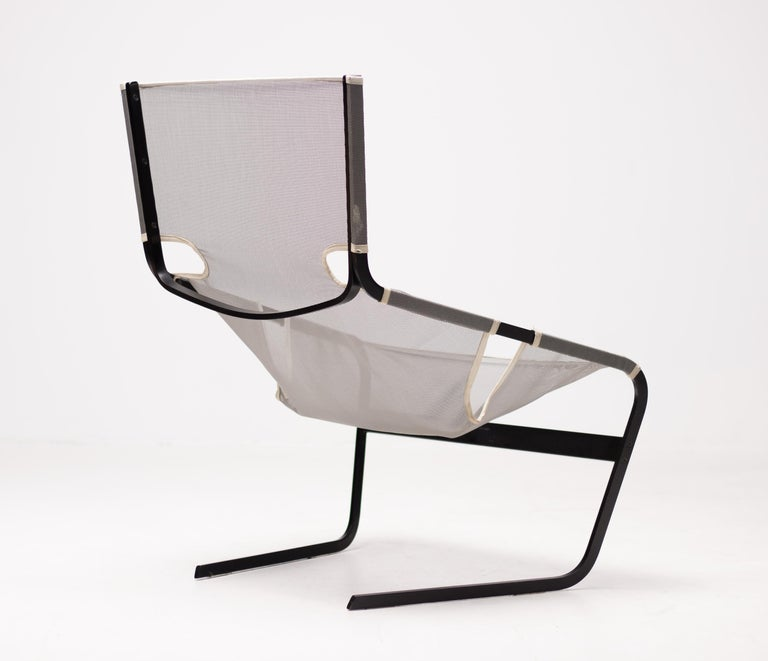 Unusual implementation of this well-known Pierre Paulin design. Black metal frame and mesh sling seat.
