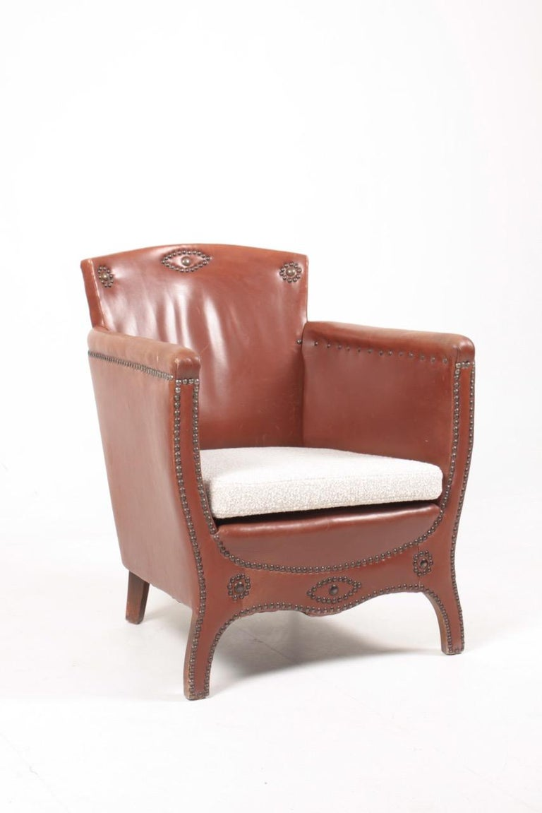 Lounge chair in leather and boucle. Designed by Otto Schulz and made by Boet AB. Great condition.