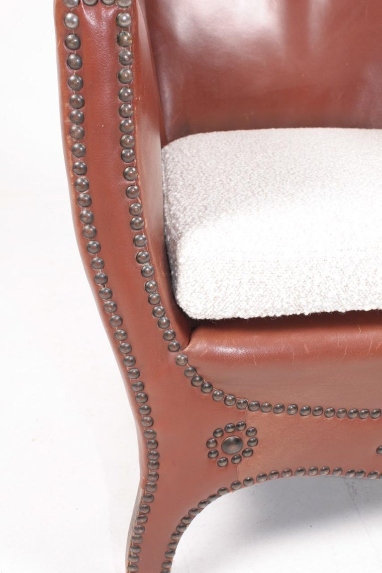 Swedish Lounge Chair in Patinated Leather and Boucle Designed by Otto Schulz For Sale