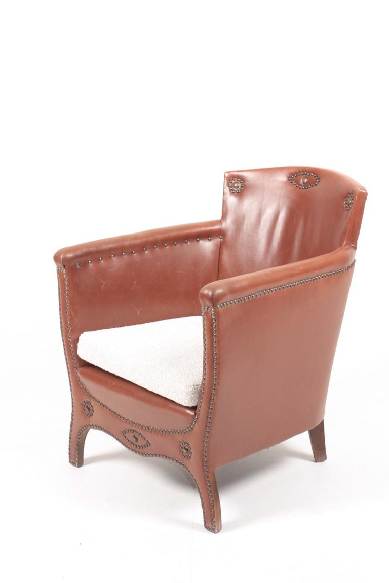 Mid-20th Century Lounge Chair in Patinated Leather and Boucle Designed by Otto Schulz For Sale