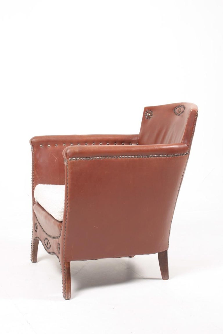 Brass Lounge Chair in Patinated Leather and Boucle Designed by Otto Schulz For Sale