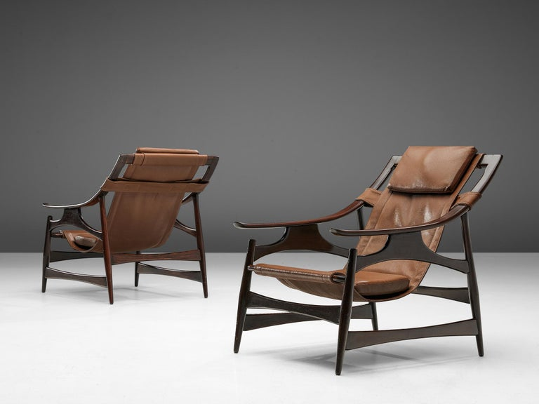 Liceu de Artes e Oficios, lounge chair, darkened embuia wood and leather, Brazil, 1960s.   Beautiful lounge chair in dark Brazilian walnut with a brown leather  upholstery. The frame is a sort of wooden skeleton. It has an open character with