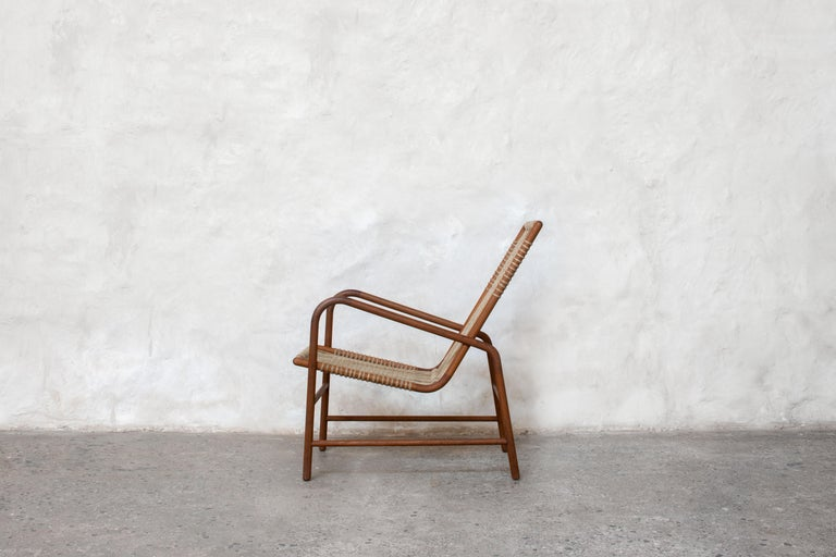 Contemporary Lounge Chair in Teak with Woven Seat in Rope Handmade by Studio Mumbai For Sale