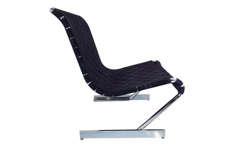 Midcentury Scandinavian cantilever chrome and webbing lounge chair.  I've never seen another one like it, this mystery lounge chair hails from Scandinavia and has been expertly crafted in chrome and canvas webbing. Using techniques pioneered by