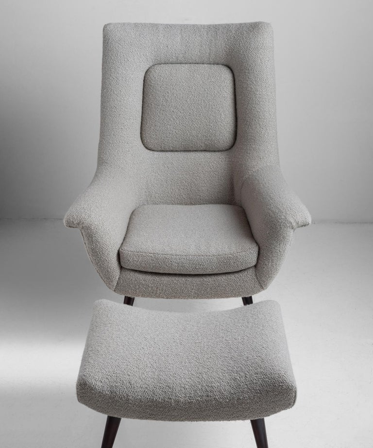 High back lounge chair with matching ottoman, newly upholstered in a textured wool blend from Maharam.   Measures: 41