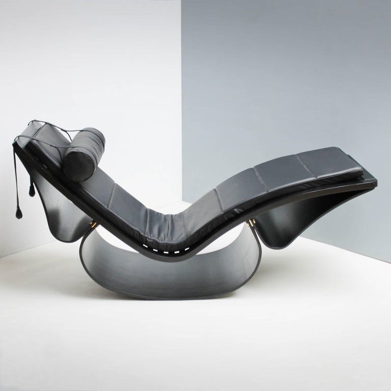 The rocking chaise or lounge chair 'Rio' by Oscar Niemeyer for Fasem International, Italy. Upholstered in black leather, frame made of black stained ash. Adjustable headrest, with two small sack, filled with lead as contra weights. This chair is