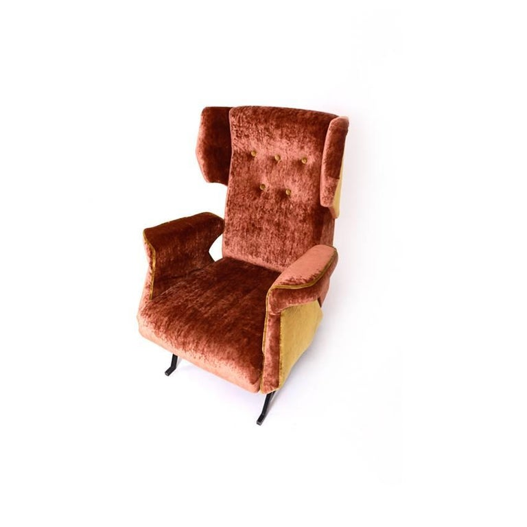 Large Italian lounge chair on iron legs with a cushioned seat, arm- and backrest. The lounge chair was reupholstered with a high-quality soft fabric in copper and gold.