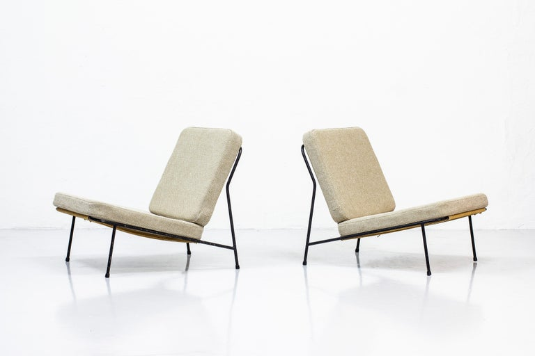 Pair of lounge chairs designed by Alf Svensson. Produced by Ljungs industrier during the 1950s in Sweden. Rare early metal version with original flag halyard weaving in the seat. The flag halyard was later replaced with rubber bands. Newly