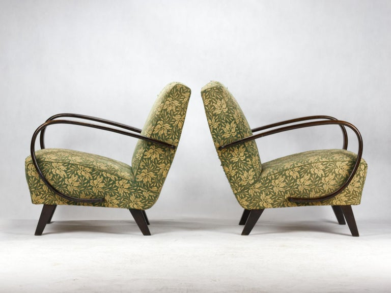 This lounge chairs, model no. 2, were designed by Jindrich Halabala and produced in Czechoslovakia in the 1930s by UP Zavody Brno. The chairs curved armrests and legs made from stained beech and chairs are upholstered in original fabric. The chairs