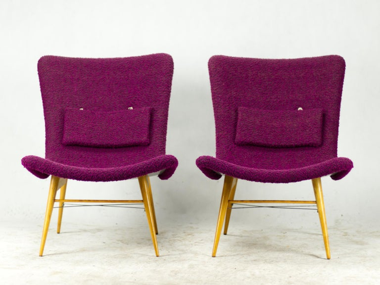 Vintage fiberglass TV chairs designed by Czechoslovak designer Miroslav Navrátil in the 1960s. The shell construction is made from fiberglass. The small pillow is removable, holding on leather straps. Chairs in good original condition.