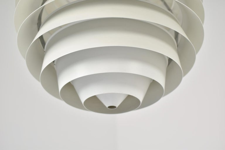Stunning 'Louvre' pendant designed by Poul Henningsen for Louis Poulsen, Denmark, 1957. Originally designed for the Adventist Church in Skodsborg. Created from 13 matte white lacquered shades that provide a uniform light spreading. Beautiful