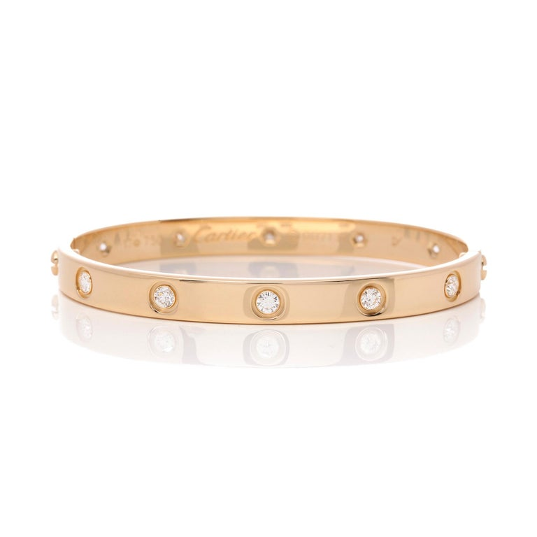 This bangle by Cartier is from their Love Collection and is in 18ct Yellow Gold. It features 10 round brilliant cut diamonds. Complete with Cartier box and certificate. Our Xupes reference is J515 should you need to quote this.