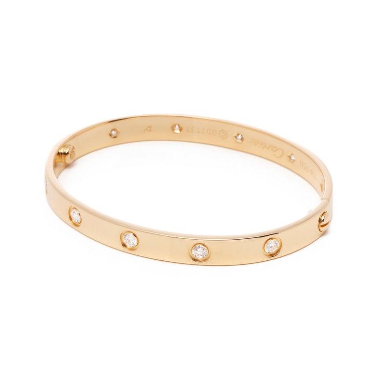 Contemporary Love 10 Diamond 18 Carat Yellow Gold Bangle For Sale