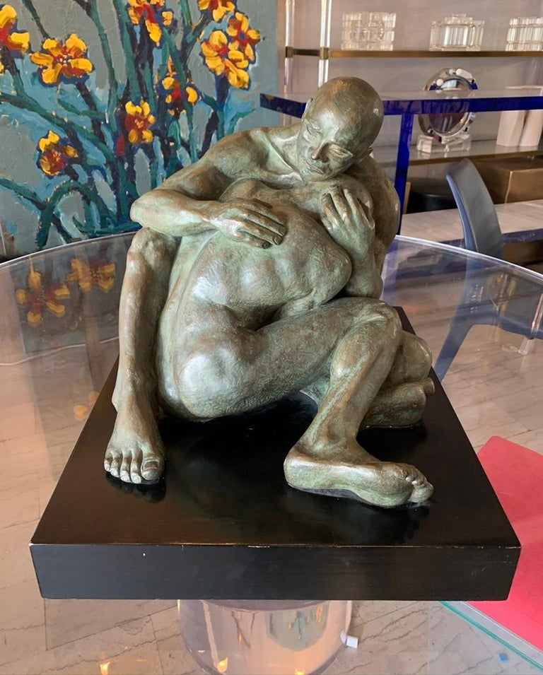 Beautiful bronze sculpture of 2 nude males embracing titled LOVE by Norma Goldberg, dated 1977  The piece can really communicate the love this couple feel for each other and how protective one is of the other.  The piece is mounted on a wooden