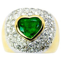 Love Emerald of in 18 Karat Yellow Ring with Pavé of Diamonds Set in White Gold