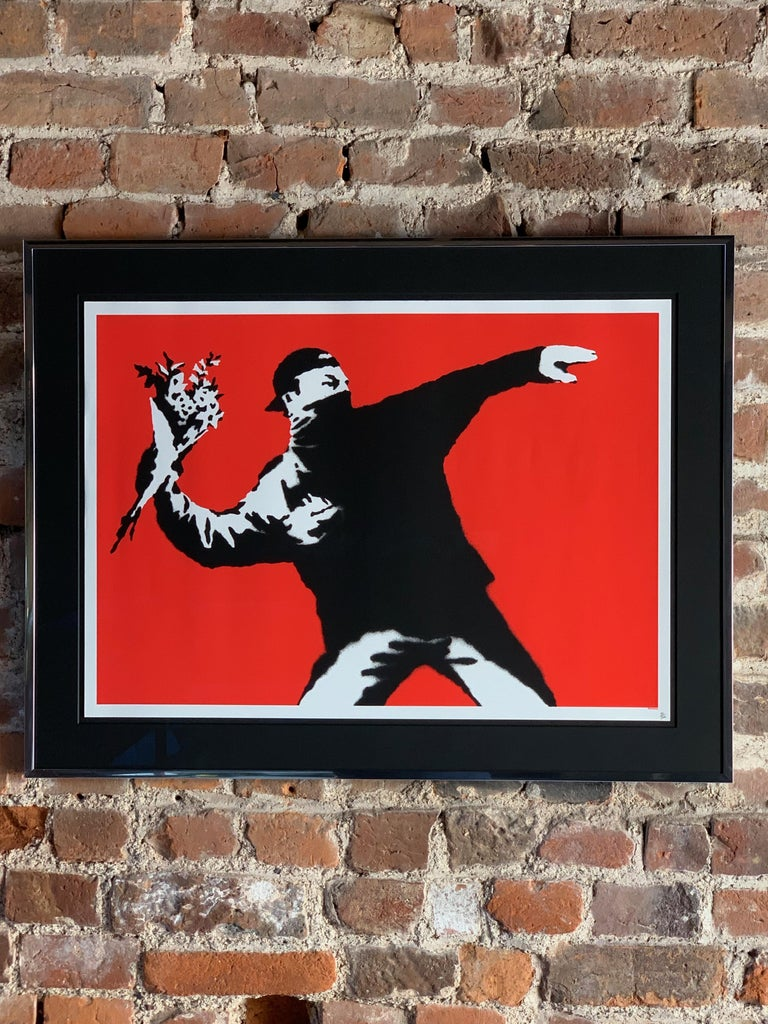Love Is In The Air (Flower Thrower) 2003 Banksy   Love Is In The Air, also known as the Flower Thrower, by Banksy first appeared in 2003 as a large format stencilled graffiti in Jerusalem shortly after the construction of the West Bank Wall. The