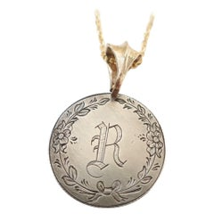 """Love Token with Engraved """"R"""" on a Silver Quarter and Gold Bail"""
