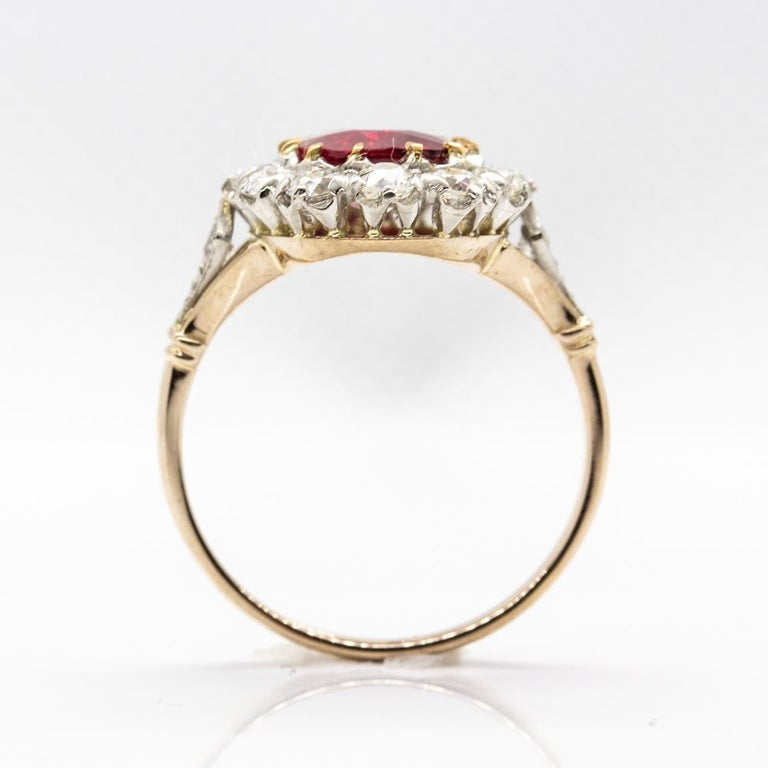 Lovely 18 Karat Gold GIA Certified Ruby and Diamonds Halo Ring In Excellent Condition For Sale In Aventura, FL