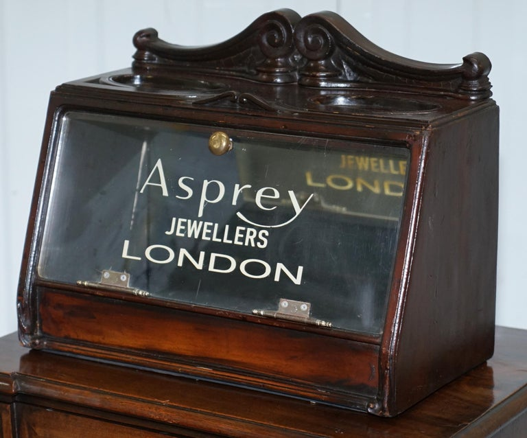 We are delighted to offer for sale this stunning mirrored back Asprey London Jewellers display case  A very good looking and well made display cabinet from one of the greatest jewellers and silver smiths England has ever known  Haberdashery and