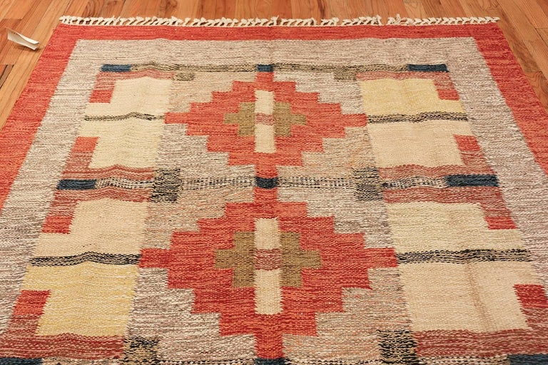 Vintage Scandinavian Swedish Kilim, Country of Origin: Sweden, Circa Date: Mid 20th Century. Size: 6 ft x 9 ft 9 in (1.83 m x 2.97 m)  Simple, blocked shapes set the tone throughout this attractive kilim, keeping with the elegantly understated