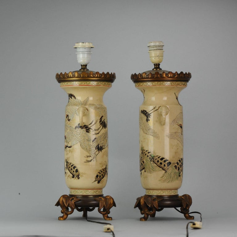 Nice quality with superb decoration of cranes and turtles. With elephant handles. Both lamps are working!  The additions are bronze    Condition: Overall condition; Vase 1; restoration to neck and 1 handle restored, Vase 2; No damages. Size: