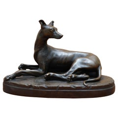 Lovely Bronze Statue of a Whippet Dog Laying Down with a Expecting Expression
