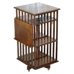 Lovely circa 1900 Edwardian Solid Oak Revolving Bookcase with Lift Up Desk Piece