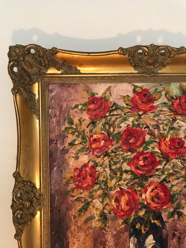 Lovely antique oil on canvas painting in the figurative style by Danish artist Braabye. This very bold painting depicts a vase of red roses on a table. The colors are still vibrant, thick and coarse. This painting is set in a beautiful giltwood