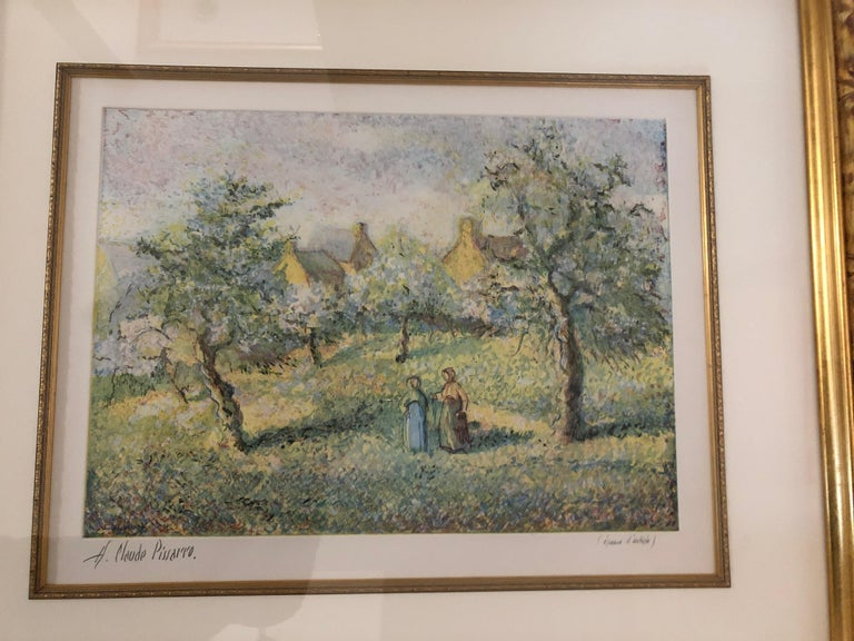 A beautiful pastel colored landscape of trees in bloom (Arbrers en fleurs) with two women walking down a country road. Aquatint by H Claude Pissarro, signed lower left. Gorgeous custom gilded frame, linen mat and interior gold filet. Art measures 19