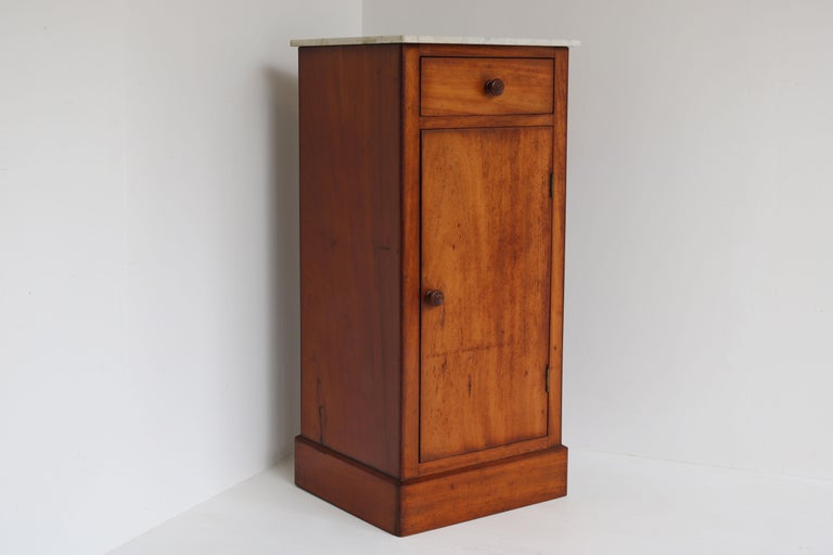 Lovely French antique night stand in Mahogany with Italian Carrara marble top 19th century The cabinet looks great with its mahogany woodgrain and aged patina.  The cabinet has 1 drawer & 1 door with large storage  Finished on all 3 sides, looks