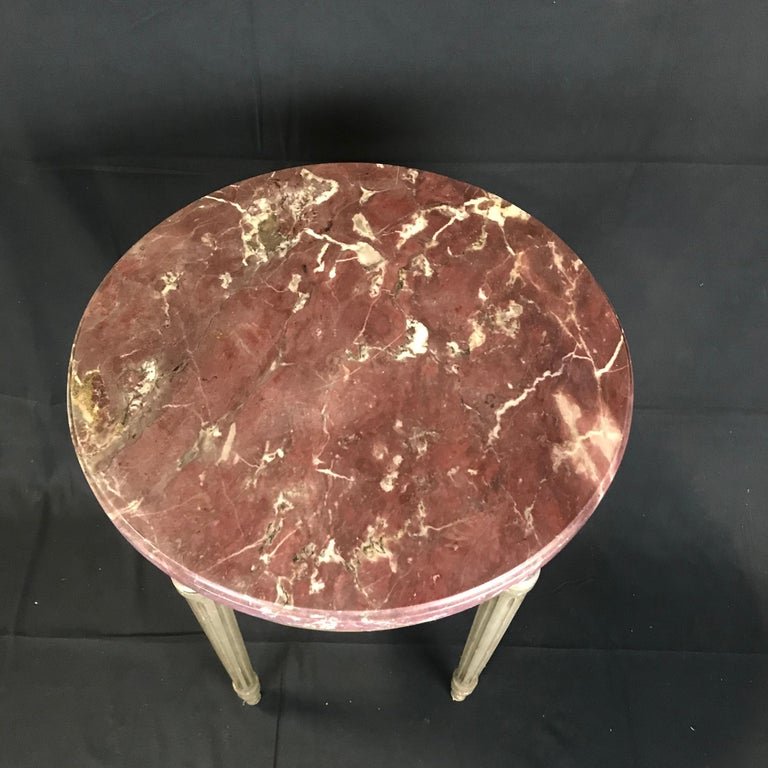 """A versatile round French side or end table having painted carved wood base in Classic French style and topped with a stunning rouge marble.  #4428  H skirt 21""""."""