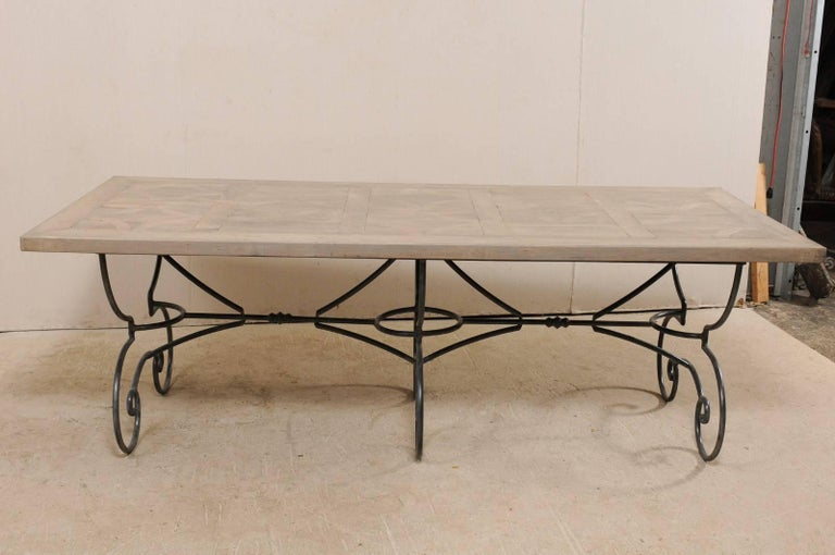 Carved Lovely French Vintage Table with Inlay Wood Top On Large Scrolling Iron Base For Sale