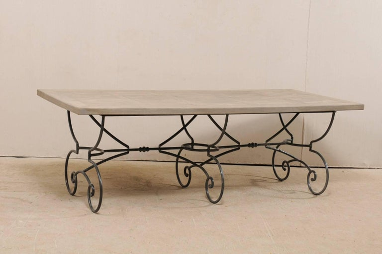 Lovely French Vintage Table with Inlay Wood Top On Large Scrolling Iron Base In Good Condition For Sale In Atlanta, GA