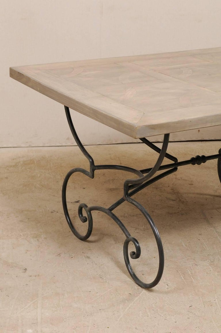 20th Century Lovely French Vintage Table with Inlay Wood Top On Large Scrolling Iron Base For Sale