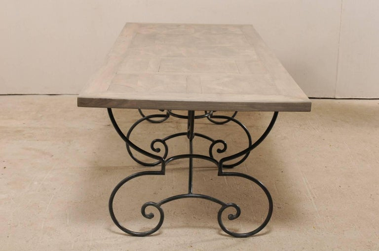Lovely French Vintage Table with Inlay Wood Top On Large Scrolling Iron Base For Sale 1